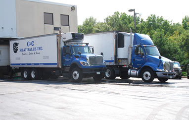 Two of our trucks posing for a photo